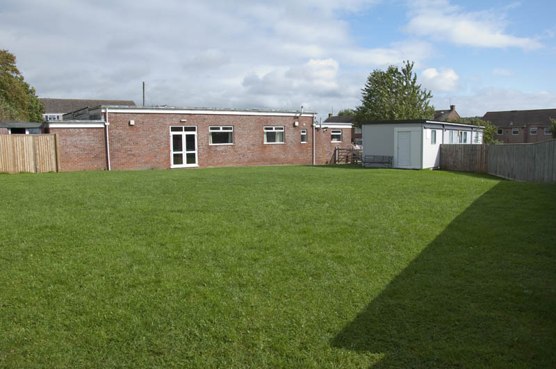 Outdoor field behind the hall